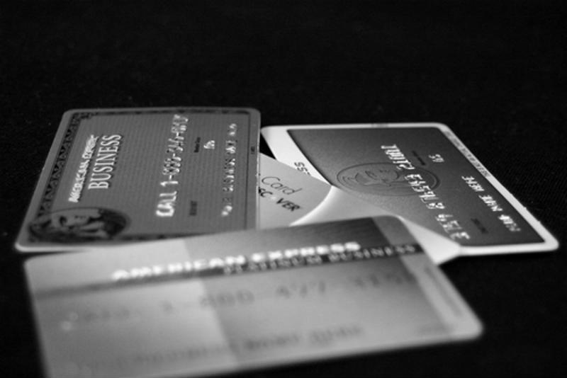 Black and white photo of credit cards.