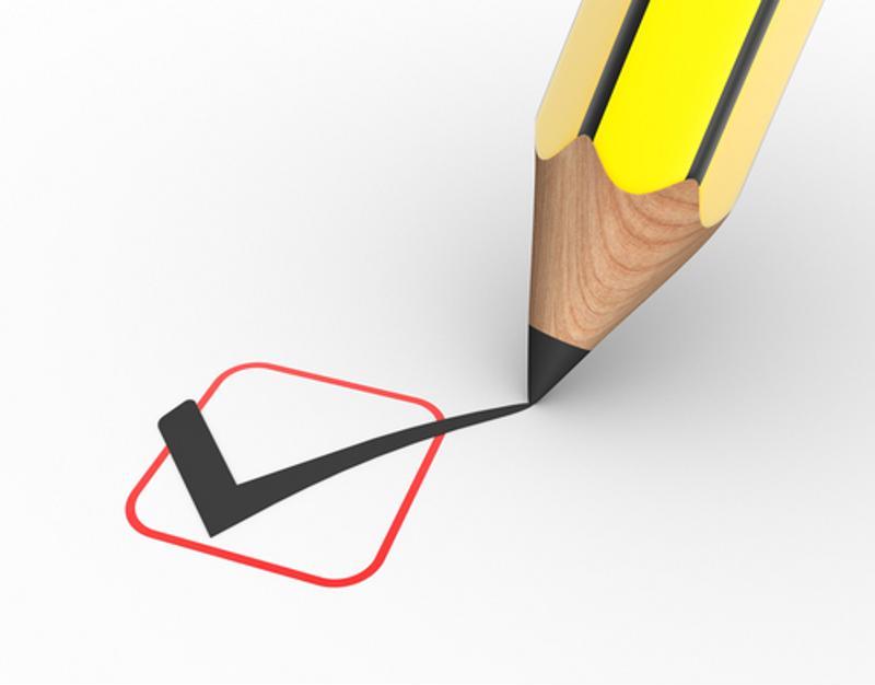 A pencil checks off a checklist item.