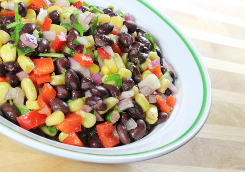 Bowl of diced tomato, onion, corn, black beans