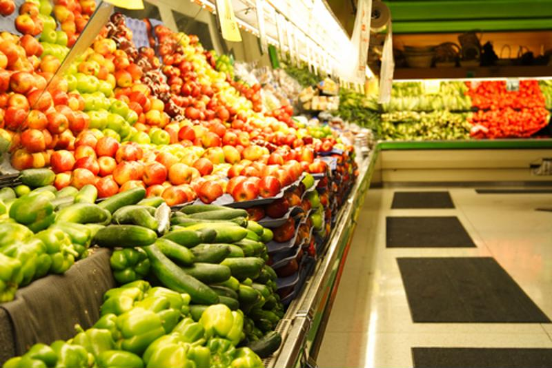 Produce on display in a grocery store.