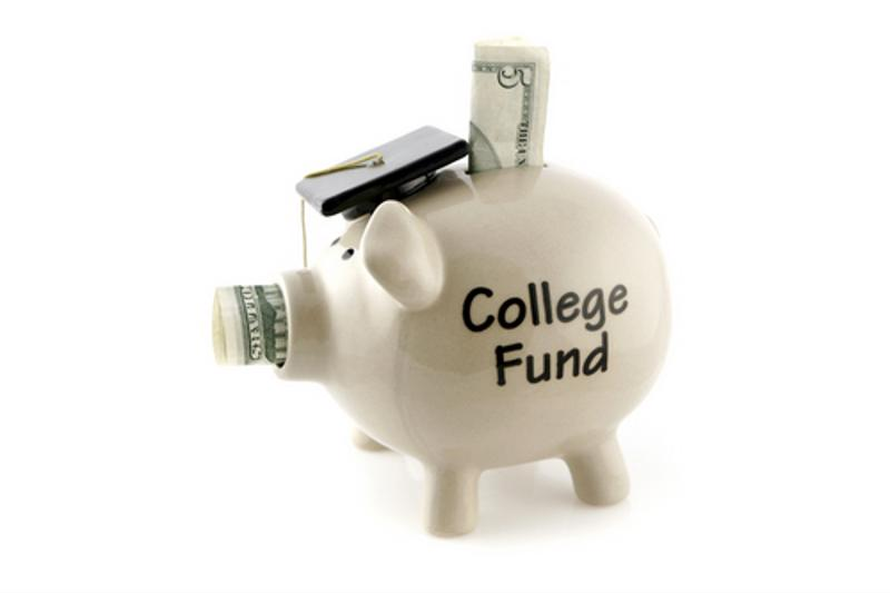 "A piggie bank stuffed with money, wearing a graduation cap. The side of the bank is labeled ""College Fund."""