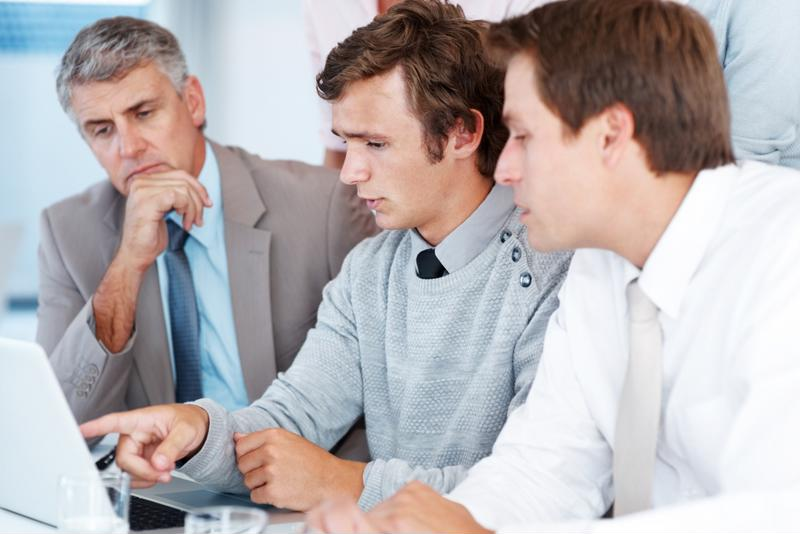 IT manager trains new hire on internal IT policies and controls.