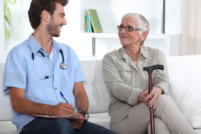 Male nurse talking to patient.