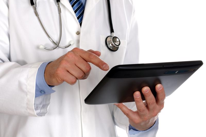 A doctor working on a tablet.