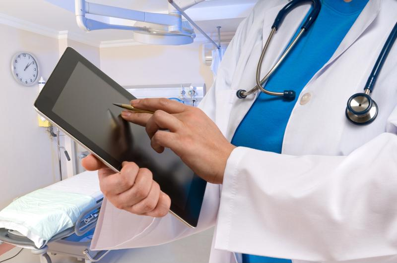 Photo of health provider using tablet computer.