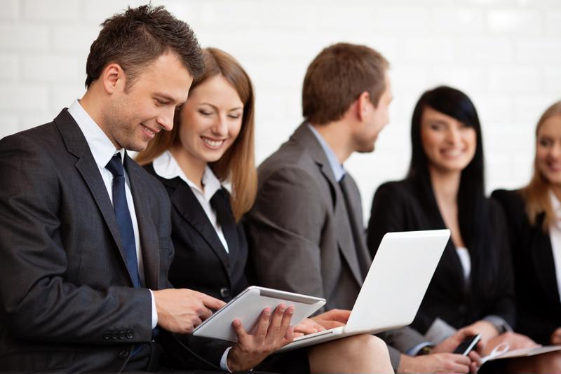 Businessman showing business woman something on his device