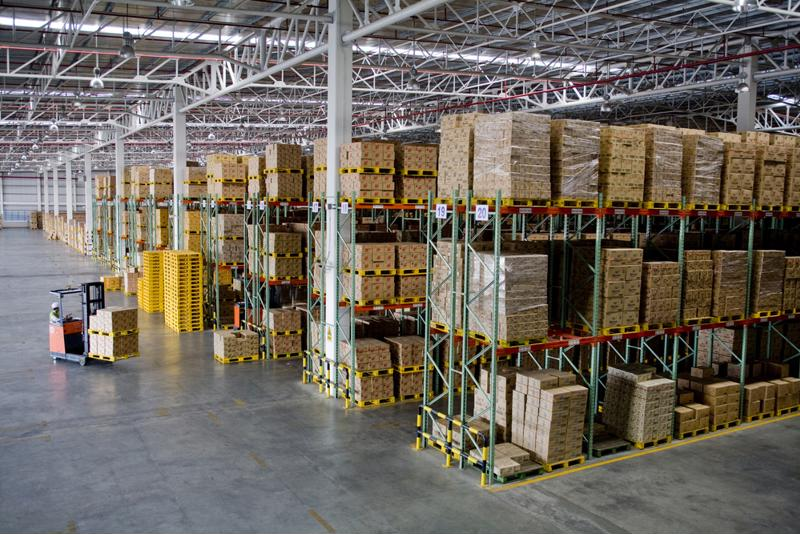 A warehouse with a forklift.