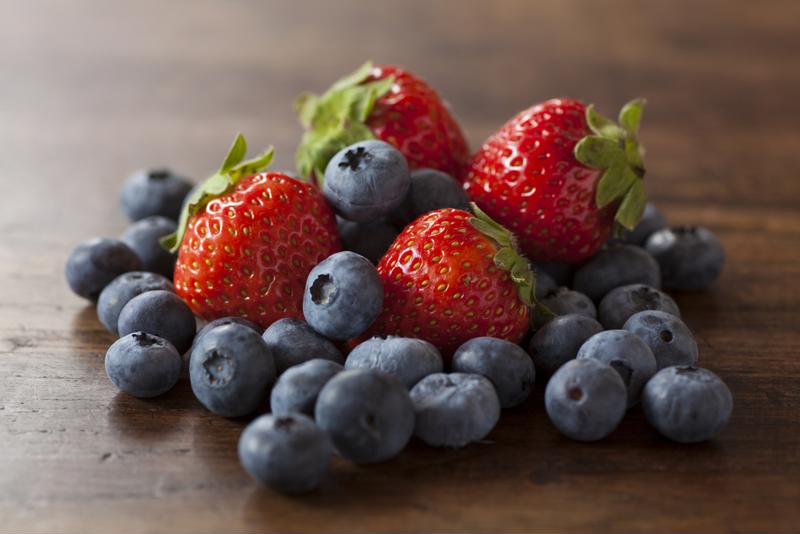Adding fresh strawberries and blueberries is not only pleasing to the mouth, but to the eye as well!