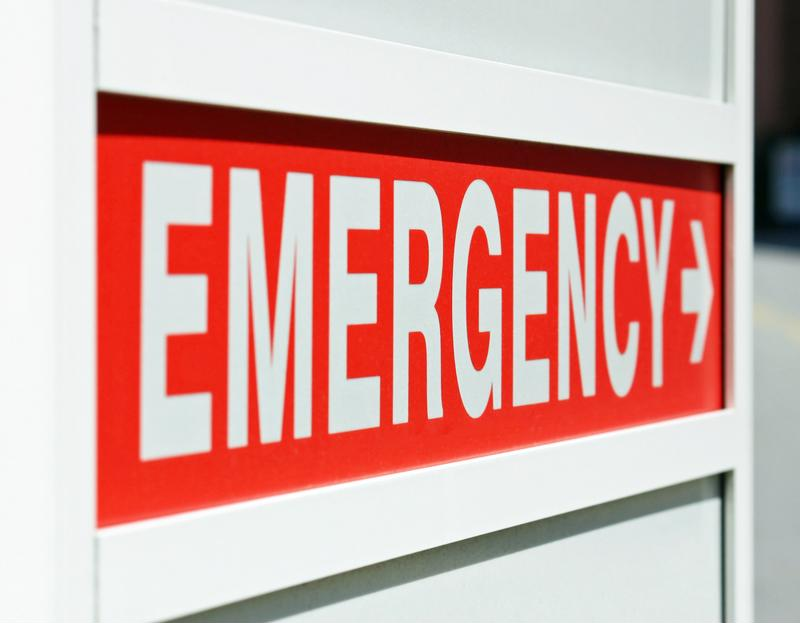 Red emergency sign with arrow.