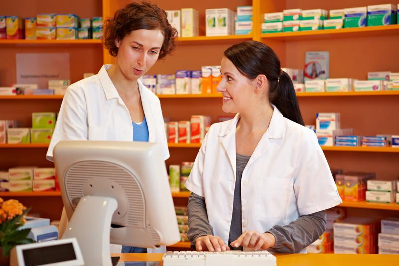 Two female pharmacists interacting.