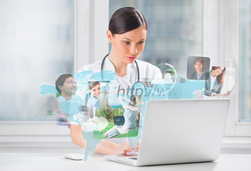 Nurse wearing white lab coat and stethoscope sitting at a laptop surfing the internet.
