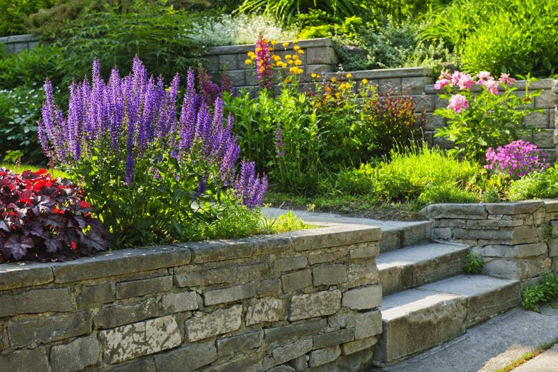 Stone siding goes great for concealing your front yard garden.