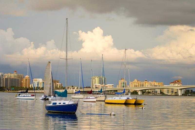 Sailboats are anchored off the coast of Sarasota, Florida.