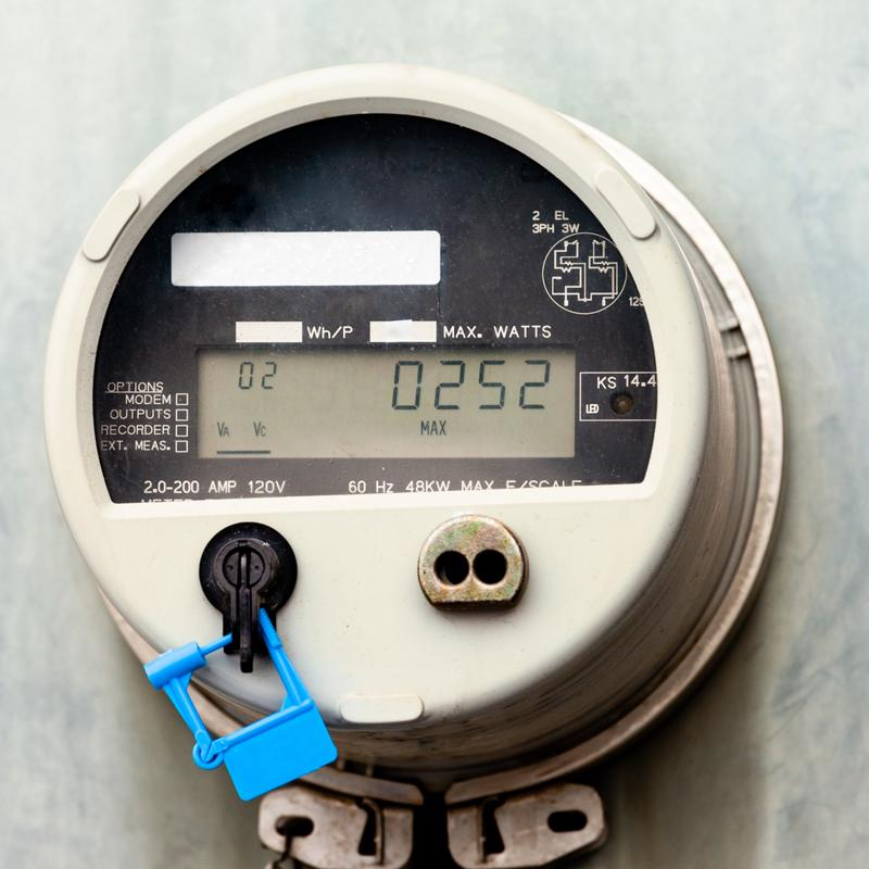 A power meter on a building.