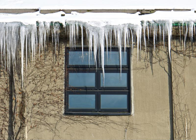Ice dams can form during the winter on a home roof from uncleaned gutters.