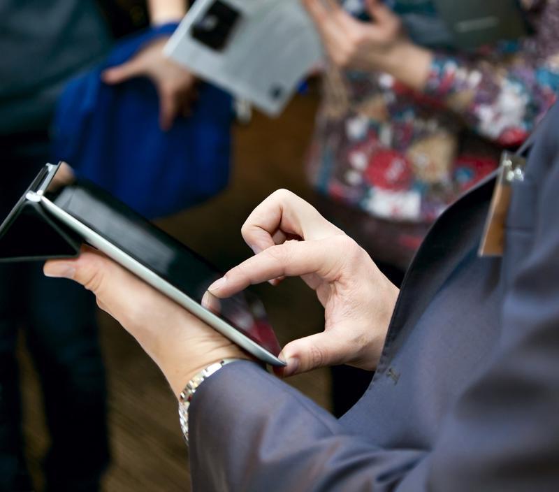 Businessman using iPad