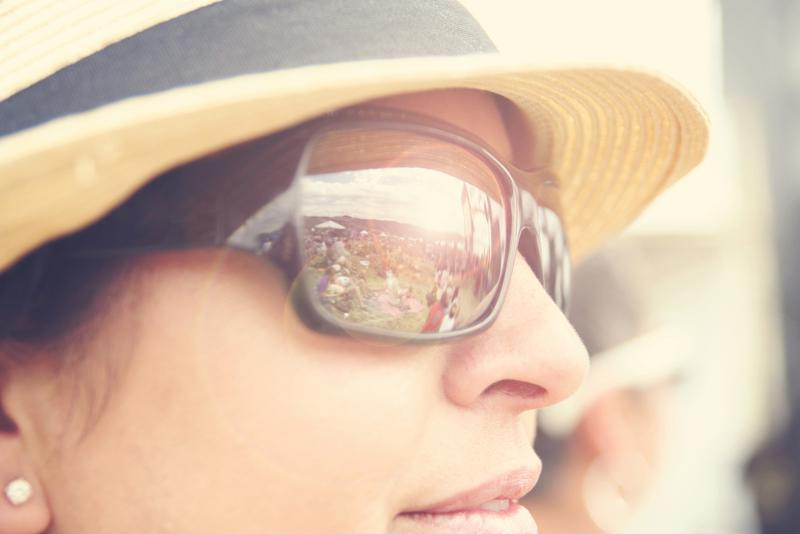 Stay protected from pollen with a hat and sunglasses while outdoors.