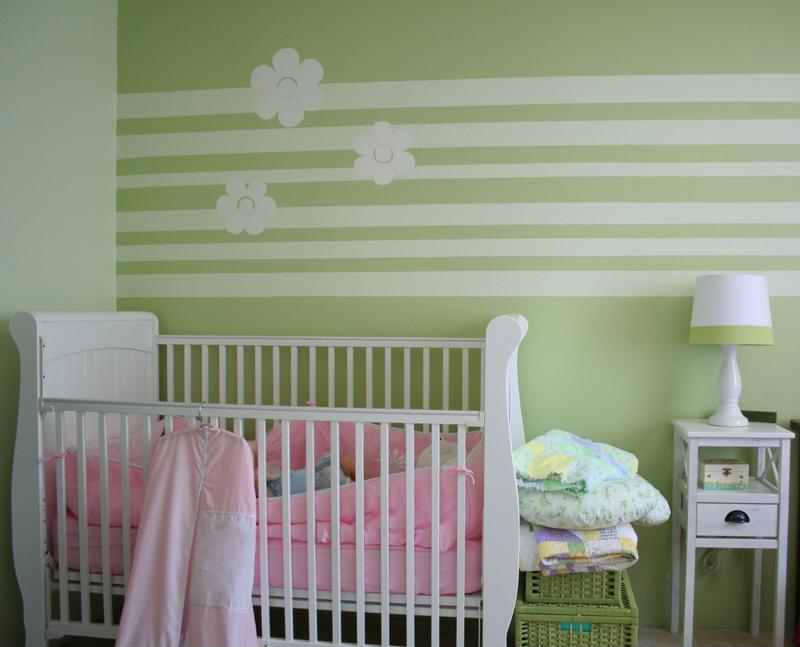 Baby's nursery with white crib.