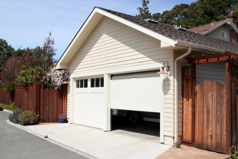 A garage door begins to open.