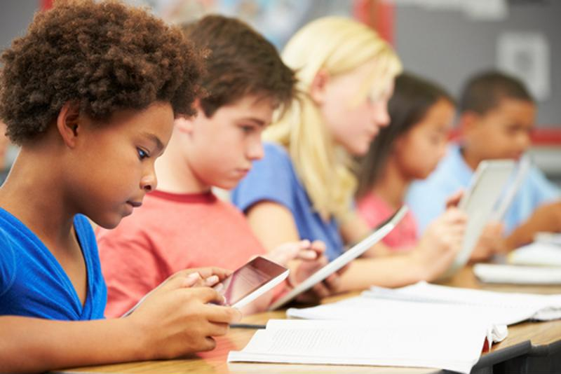 Students use tablets in the classroom
