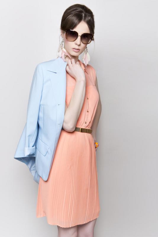 woman in sunglasses, pastel jacket, dress