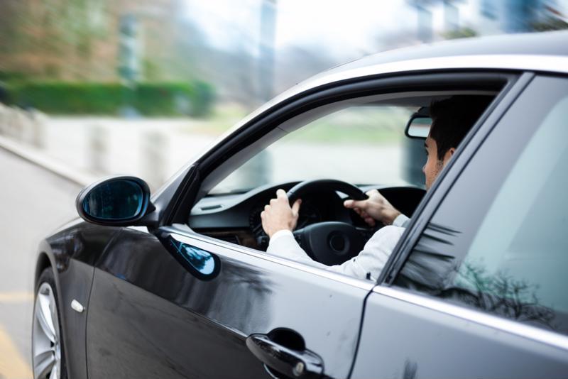 A man drives a vehicle.