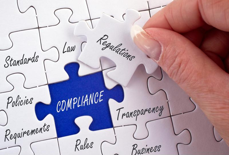 "A puzzle emblazoned with the word ""compliance""."