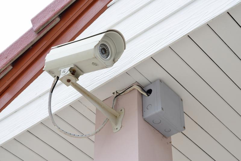 Security camera on side of smart home.