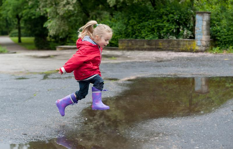 Your kids will love if you join them in jumping in puddles.
