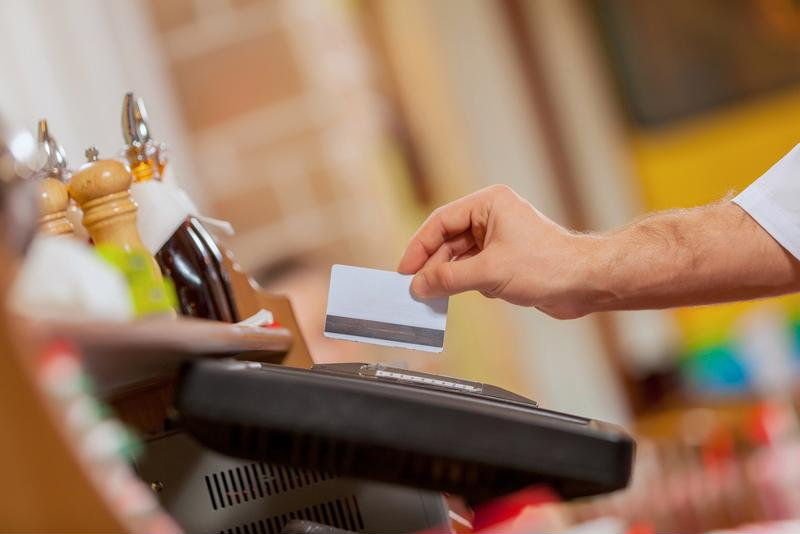 Americans are still swiping their credit cards, but not as much as they used to.