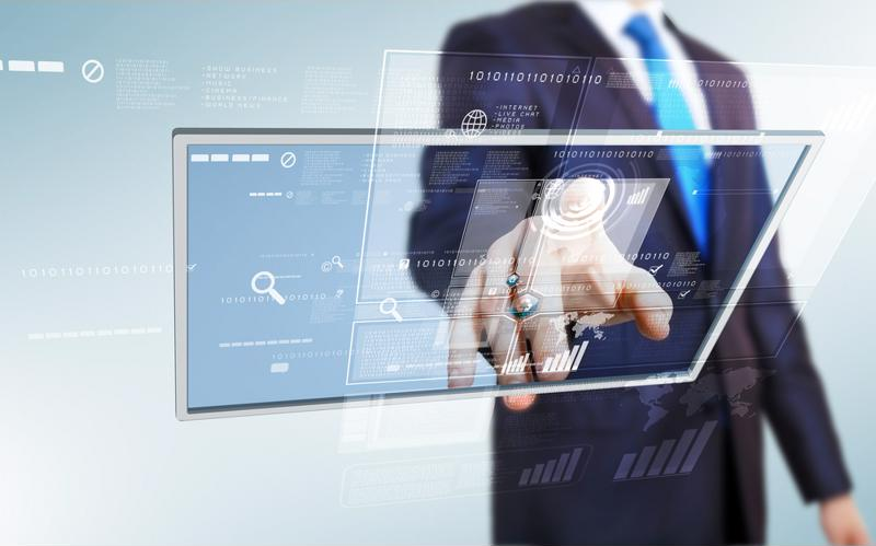 Concept image of businessman wearing suit and working on virtual screen