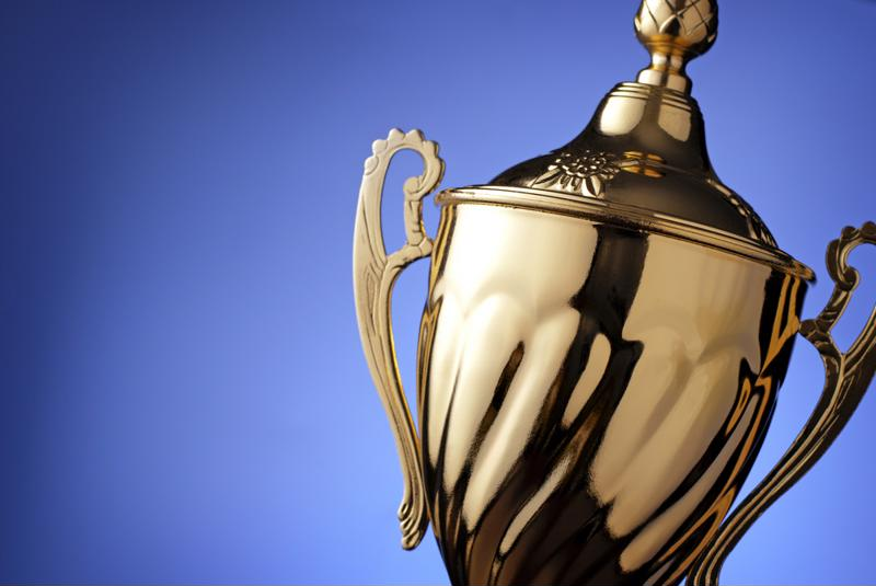 Gold trophy with a blue background