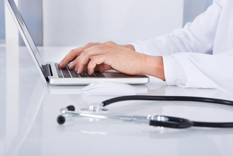 A doctor on a computer