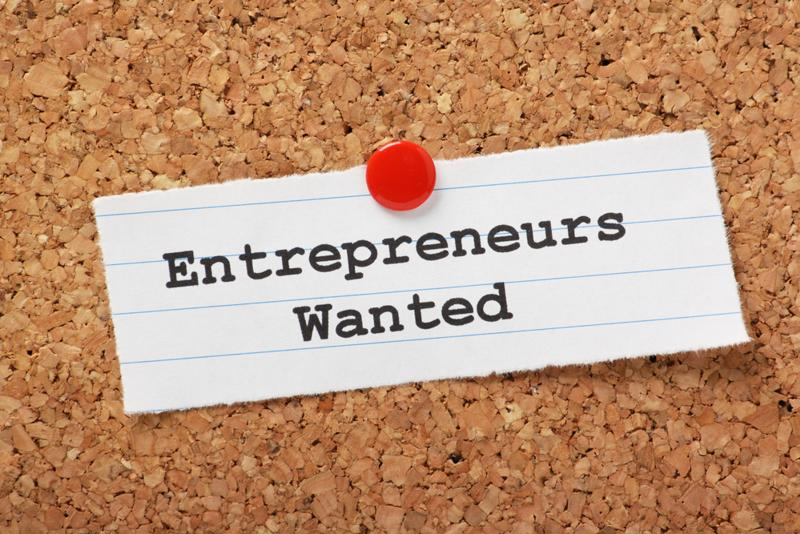 "Paper pinned to bulletin board with the words, ""Entrepreneurs wanted."""