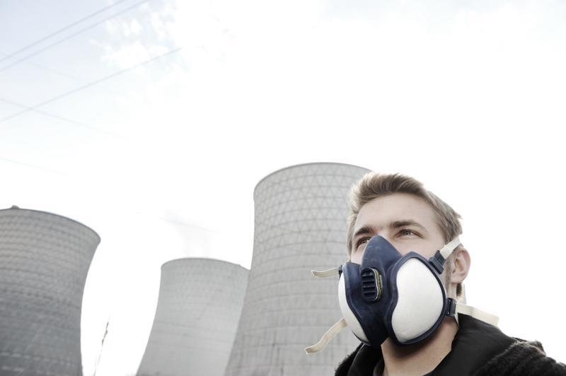Man wearing respirator.