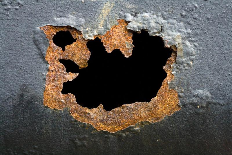 Rusty hole in metal