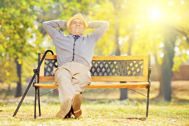Senior man relaxing on bench