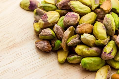 Chop pistachios for a vibrant and delicious coating.