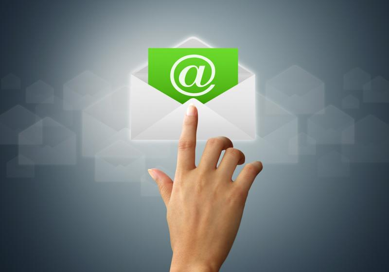 A concept image of a hand clicking an email icon.
