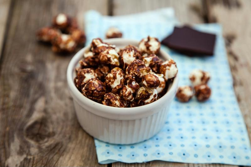 Chocolate and peanut butter can change the way you eat popcorn forever.