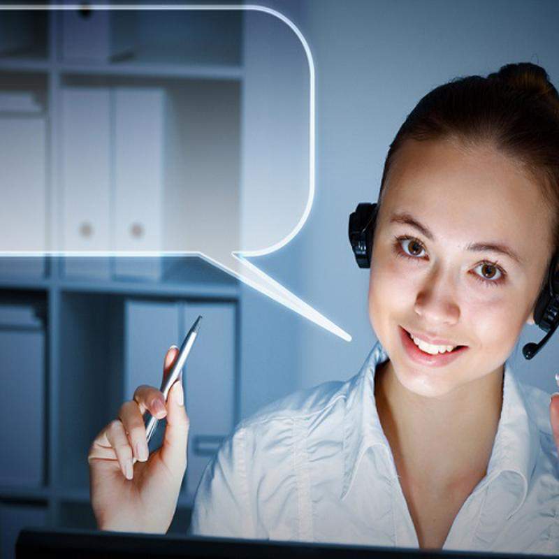 Woman wearing a headset with a blank speech bubble next to her head.