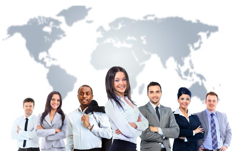 Group of professionals in business dress standing in front of world map.
