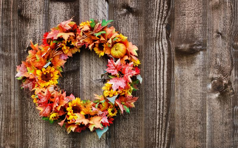 Consider using a fall wreath as part of a centerpiece.