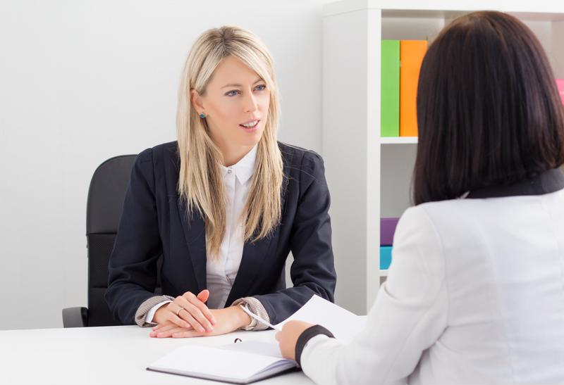 Two women in the middle of a job interview.