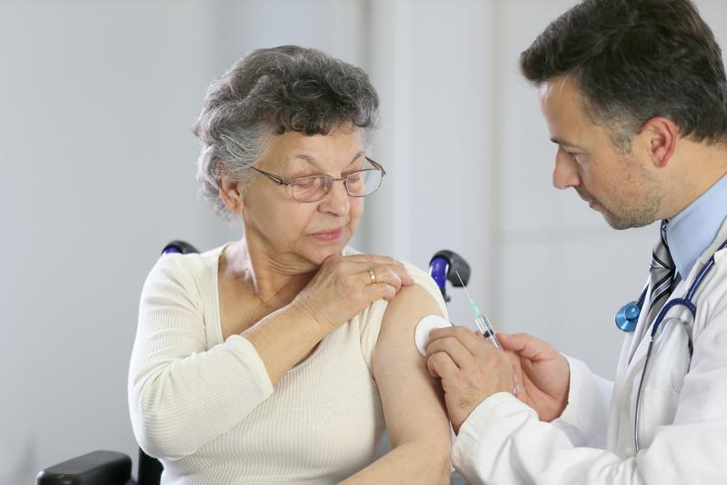 senior woman getting flu shot