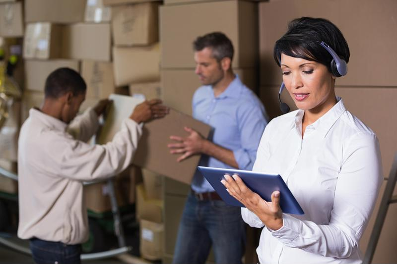 woman holding tablet in warehouse