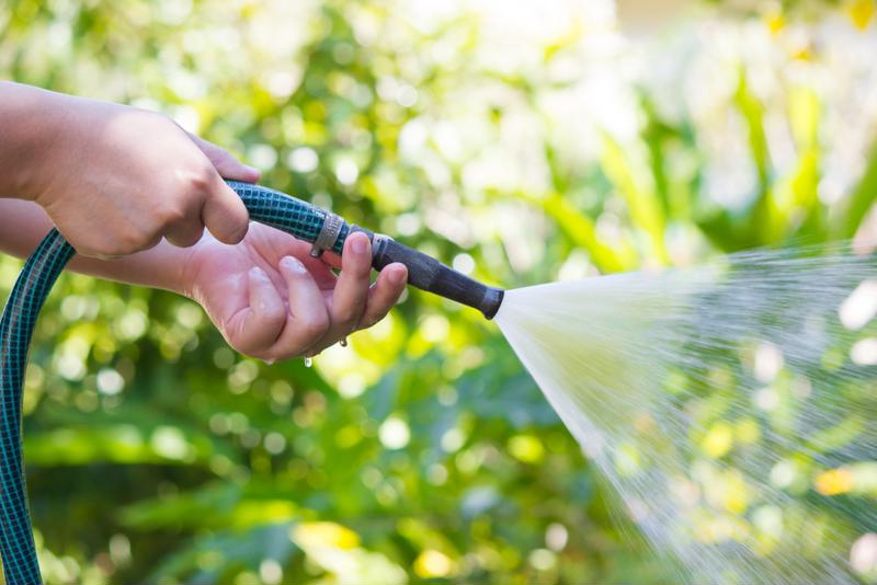 A simple garden hose is perfect for washing off your stone siding.