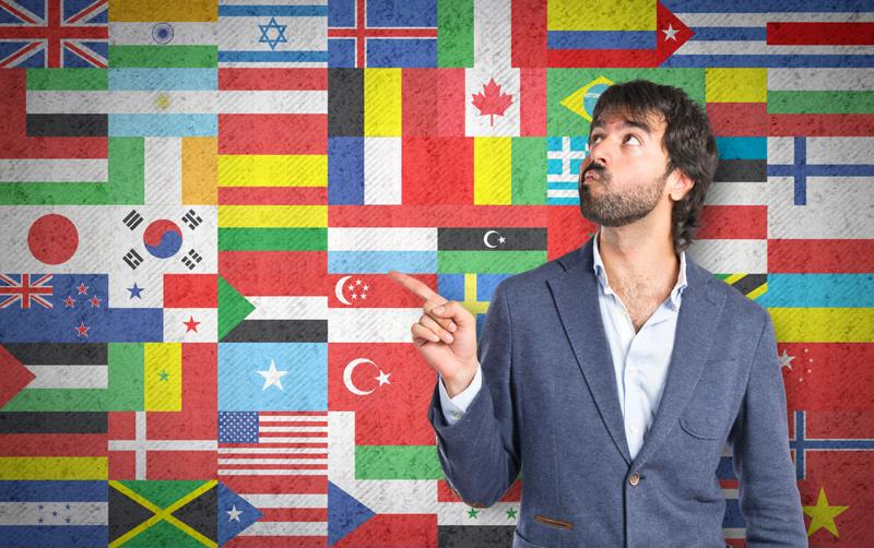 man standing in front of different flags
