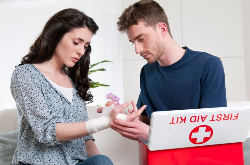 couple using home first aid kit