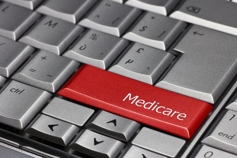 "Red key on a computer keyboard with the word ""Medicare"" on it."